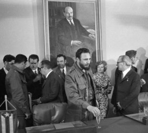 FILE - In this June 1972 file photo, Cuba's leader Fidel Castro, center, attends the signing of a bilateral agreement between the German Democratic Republic and Cuba. Castro has died at age 90. President Raul Castro said on state television that his older brother died late Friday, Nov. 25, 2016. (AP Photo/Prensa Latina via AP Images/Rogelio More, File)